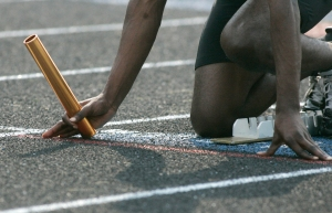 May 11, 2011. The baton is valuable in all relay races. Here a track athlete prepares for the start of a relay. The GWOC track meet took place at Fairborn High School.